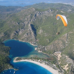 A paraglider soars high over the Blue Lagoon